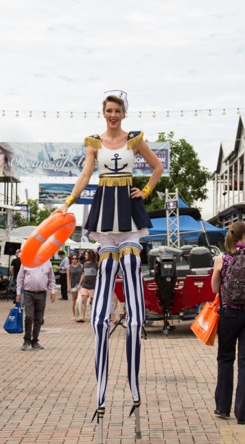 Boat Show lady on stilts
